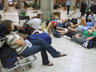 Tourists wait at Bali's airport for flights home. Photo: Reuters